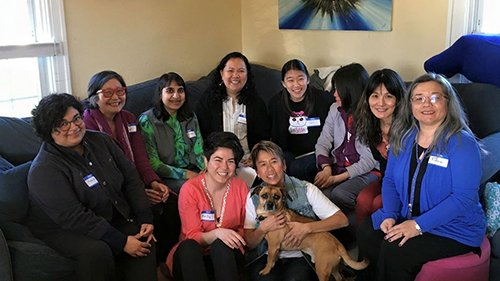 OPAWL members at a community event in a home