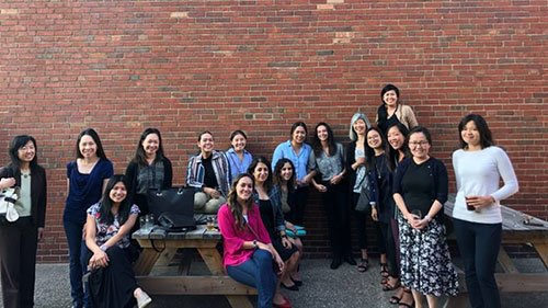 OPAWL group photo outside in front of brick wall